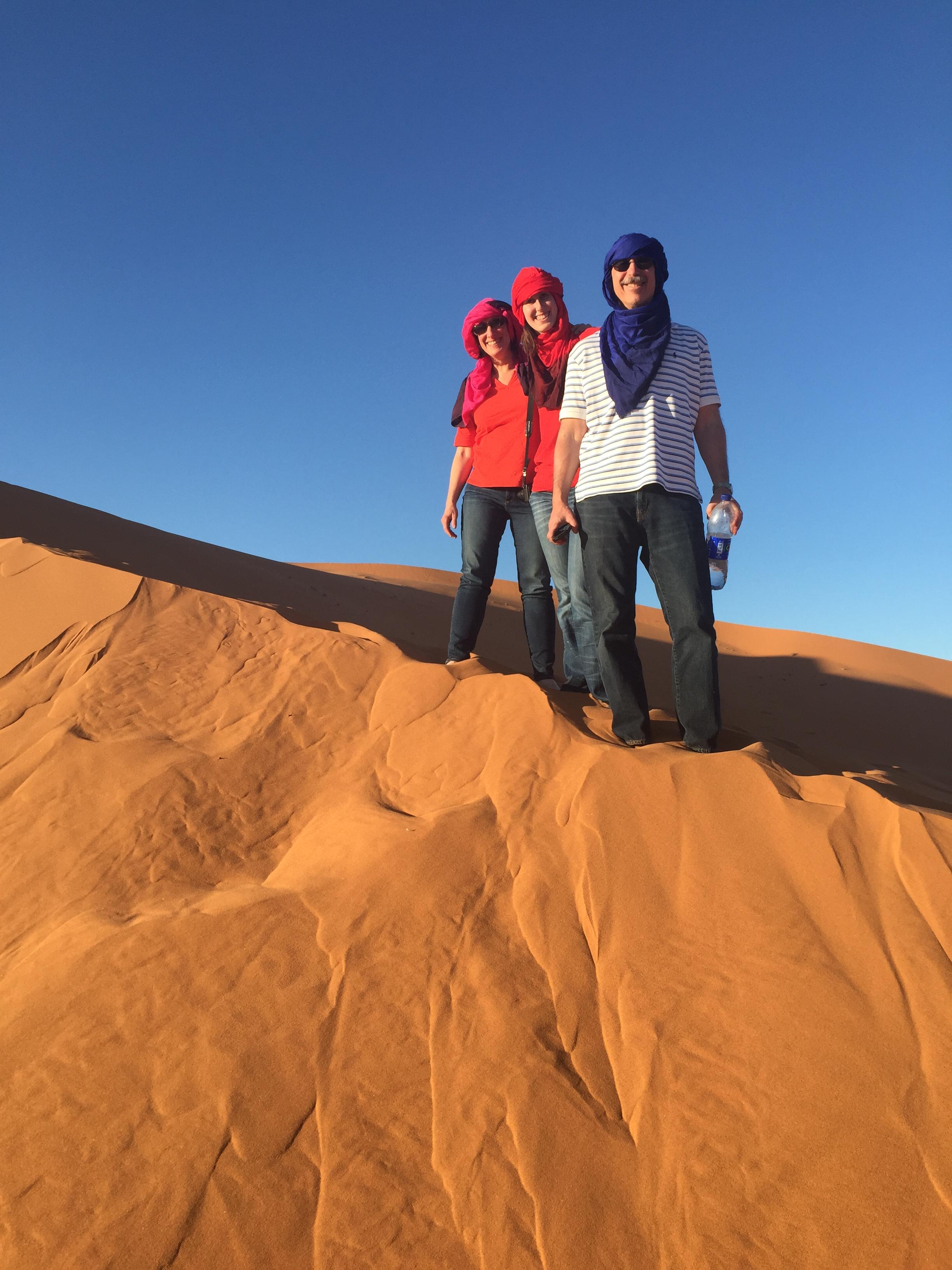 Standing on the Sahara Desert sand dune